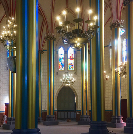 The restored color scheme within the cathedral interior. The columns are now returned to their original gold and blue colors, and the walls are re-stenciled according to what research suggests they originally looked like in 1887. Photo: Anthony E. Clark Private Collection
