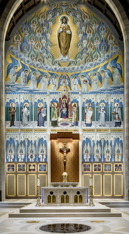 Our Lady, Seat of Wisdom, and Christ the High Priest are surrounded by saints and angels in the new mural covering the back wall of the apse. Photo credit: William Heyer Architect