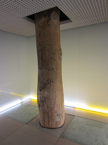 A tree trunk is featured in the Meditation and Prayer Room of Munich Airport. Photo: Jake and Meridel