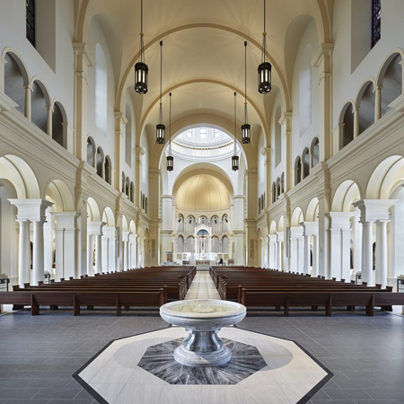 Nave with baptismal font. Photo: O'Brien and Keane