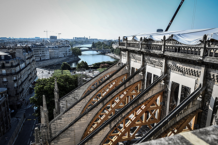 Work to stabalize the vaults and flying buttresses was in progress over the summer. Photo: Pool AFP via AP Images